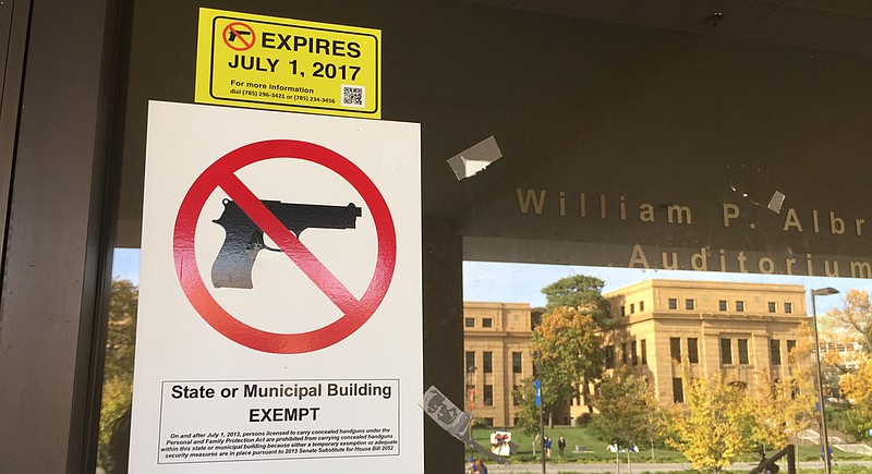 gun free sign ku